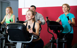 People training on exercise bikes together Royalty Free Stock Photography