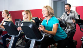 People training on exercise bikes together Royalty Free Stock Photos