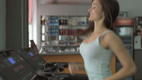 People training in fitness club, gym and sport activity. Woman exercising and running on treadmill. Pretty girl running in the simulator, jogging track stock footage