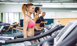 People training over treadmills on fitness center Stock Photography