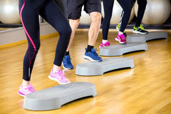 People training with step platform at fitness gym center Royalty Free Stock Photo
