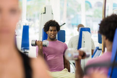 People training and working out in fitness club Royalty Free Stock Image