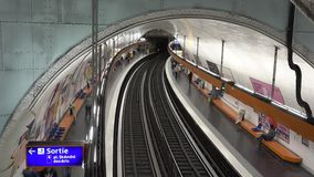 People and trains coming and go fast in subway station, time lapse, aerial view. UHD 4K stock footage