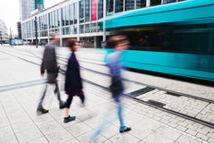 People and a tram in the city Royalty Free Stock Photography