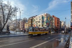 People and tram at Graf Ignatiev street in Sofia, Bulgaria. SOFIA, BULGARIA - NOVEMBER 29, 2017: People and tram at Graf Ignatiev street in Sofia, Bulgaria Royalty Free Stock Photo