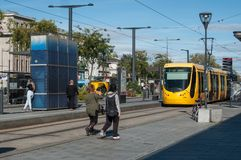 People and tramway in front of the train station Royalty Free Stock Image
