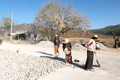 People transporting stones for road construction near Pindaya on Stock Image