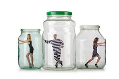 The people trapped in the glass jar Stock Photo