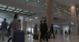 People with travel bags in Seoul airport, South Korea stock footage