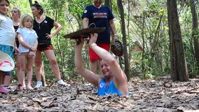 People travel Cu Chi Tunnels. People travel and trying to play entering tunnel at Cu Chi Tunnels on January 23, 2016 in Ho Chi Minh, Vietnam stock video