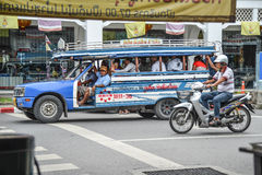 People travel by local minibus in Phuket. Royalty Free Stock Photography
