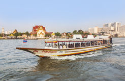 People travel in the morning with longboats at the river Chao Ph Royalty Free Stock Images