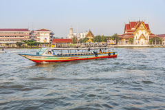 People travel in the morning with longboats at the river Chao Ph Royalty Free Stock Photo