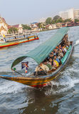 People travel in the morning with longboats at the river Chao Ph Stock Image