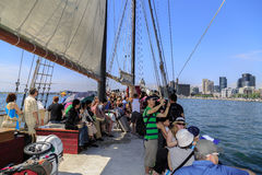 People travel on old vintage tall ship toward downtown Toronto Royalty Free Stock Photography
