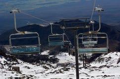 People travel on Ski lift to top of Mount Ruapehu Royalty Free Stock Image