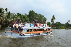 People travel in a small passenger boat in the backwaters Royalty Free Stock Image