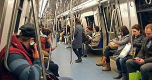 People Travel By Subway Train In Downtown Bucharest. BUCHAREST, ROMANIA - FEBRUARY 03, 2016: People Travel By Subway Train In Downtown Bucharest stock footage
