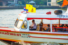 People travel in the typical long boat at the river Mae Nam Chao Royalty Free Stock Photo