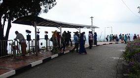 People travel and use binoculars looking penang city stock video footage