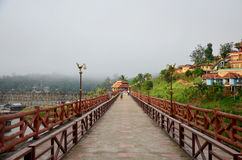 People travel and waiking on Saphan Mon wooden bridge in morning Royalty Free Stock Images