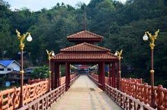 People travel and walk on Saphan Mon wooden bridge in morning ti Stock Photo