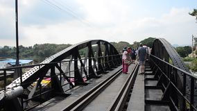People travel and walking at the Bridge of the River Kwai. On December 3, 2015 in Kanchanaburi, Thailand stock video footage