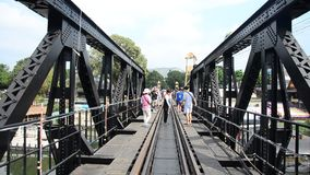 People travel and walking at the Bridge of the River Kwai. On December 3, 2015 in Kanchanaburi, Thailand stock footage