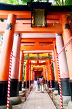 People travel and walking path inside through a tunnel of torii Royalty Free Stock Photos