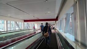 People on travelator inside Dubai metro station, United Arab Emirates. UAE, DUBAI, FEBRUARY 1, 2016: People on travelator inside Dubai metro station, United Arab stock video footage