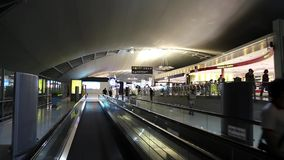 People on travelator inside international airport in Bangkok, Thailand stock video footage