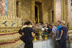 People and traveler join the thai ceremony use lotus sprinkling Royalty Free Stock Image