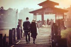 People traveling across the U Bein Bridge Mandalay stock image