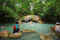 People traveling and bath in Erawan waterfall, Thailand Stock Photos
