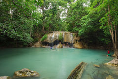 People traveling and bath in Erawan waterfall, Thailand Stock Images