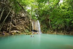 People traveling and bath in Erawan waterfall, Thailand Royalty Free Stock Photography