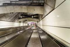 People Traveling On Escalator To Train Subway Station In Downtown Vienna. VIENNA, AUSTRIA - AUGUST 28, 2015: People Traveling On Escalator To Train Subway Royalty Free Stock Images