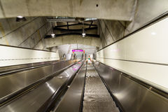 People Traveling On Escalator To Train Subway Station In Downtown Vienna. VIENNA, AUSTRIA - AUGUST 28, 2015: People Traveling On Escalator To Train Subway Royalty Free Stock Photo