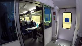 People traveling inside train in high speed. Kiev, Ukraine, October 16, 2017. Scene inside train going in high speed with many peo. Ple stock video