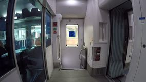 People traveling inside train in high speed. Kiev, Ukraine, October 16, 2017. Scene inside train going in high speed with many peo. Ple stock video footage