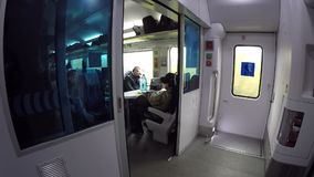 People traveling inside train in high speed. Kiev, Ukraine, October 16, 2017. Scene inside train going in high speed with many peo. Ple stock footage