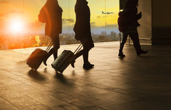 People and traveling luggage walking in airport terminal buildin Stock Photo