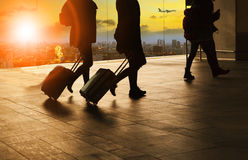 People and traveling luggage walking in airport terminal buildin Stock Photography