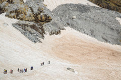 People traveling in mountains Large group of tourists.  Stock Image