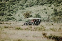 People traveling in safari on off road vehicle stock image