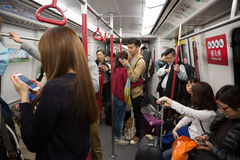 People traveling in the subway in Hong Kong Royalty Free Stock Image