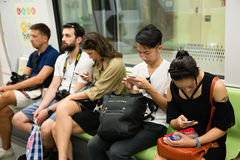 People traveling on the subway in Singapore Stock Images