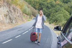 People traveling with suitcases. And car Royalty Free Stock Images