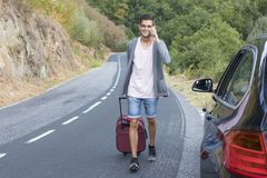 People traveling with suitcases. And car Stock Images
