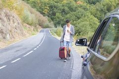 People traveling with suitcases. And car Royalty Free Stock Photography